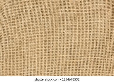 Yellow canvas fabric for background, vintage linen texture background,  burlap, jute sack