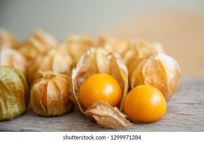 Yellow cape gooseberry fruit on wood texture.look like egg.