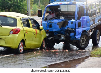 Yellow car accident Collide with a blue truck on the highway. Severe damage.