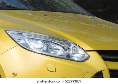 Yellow car headlights. Car exterior details