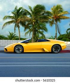 Yellow car on tropical island