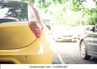 Yellow car in the car park,Background of cars in car parking lot