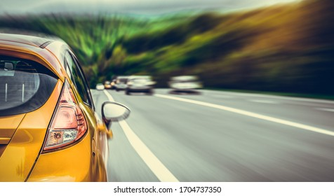 Yellow car parked on the roadside. Travel concept.