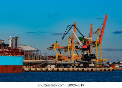 Yellow cargo cranes in the port of Riga, Europe