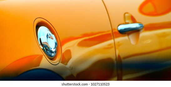 Yellow cars petrol tank cover with doors handle unique stock photograph