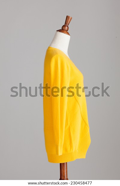 yellow cashmere sweater with wood model on grey isolated