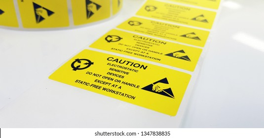 """Yellow caution label,Standard caution label with text """"Caution"""" for Electrostatic Sensitive Devices (ESD) in electronic industrial,Special label symbol for electrostatic sensitive devices"""