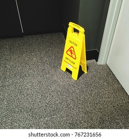 Yellow caution sign on the floor