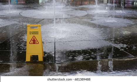Yellow Caution slippery wet floor sign with clipping path.Sign showing warning of caution wet floor,