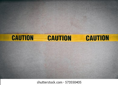 Yellow CAUTION tape barring entrance with added grain and grooming tone