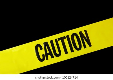 yellow caution tape on black background