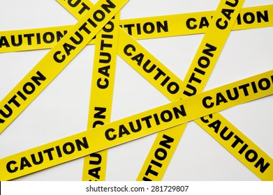 Yellow Caution tapes crossing on white background