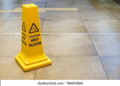 Yellow Caution wet floor sign in building.