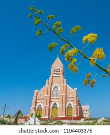 Yellow Century plant and Church   Views around the small Caribbean Island of Curacao