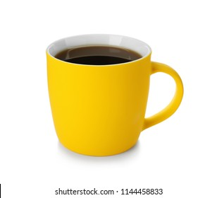 Yellow ceramic cup with hot aromatic coffee on white background