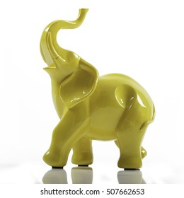 Yellow Ceramic Porcelain Elephant on White with Reflection
