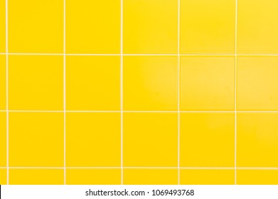 Yellow ceramic tiles background in bathroom at home