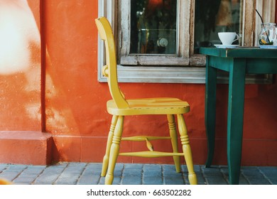 Yellow chair. Tolerance. View of terrace on the street