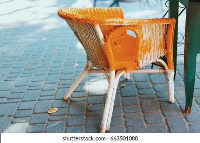Yellow chair. View of terrace on the street