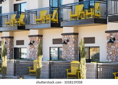 Yellow chairs on the balcones of a Cottonwood, Arizona hotel.