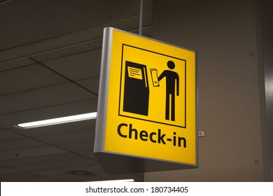 Yellow check in information sign on a airport.