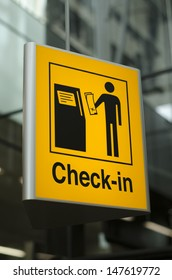 Yellow Check-in sign at the airport