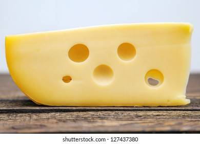 Yellow cheese on a wooden table