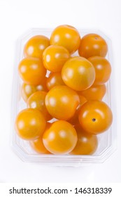yellow cherry tomatoes packaged for sale. white background