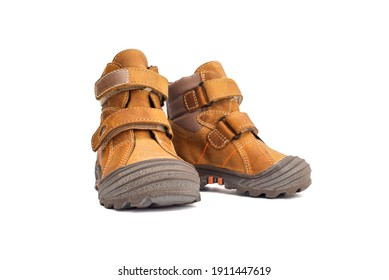 Yellow child boots from natural leather isolated on white background. Trendy casual shoes, youth style. Concept of advertising autumn winter shoes, sale, shop.