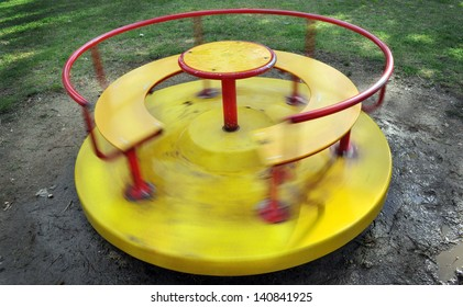 Yellow children carousel spinning round
