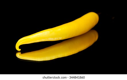 yellow  chili pepper isolated on black mirror, isolated