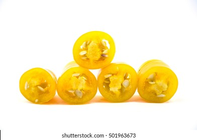 Yellow chilli pepper slices isolated on white background.