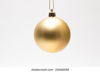 Yellow christmas decoration ball isolated on white
