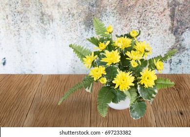 Yellow chrysanthemums on a  wooden floor and vintage background