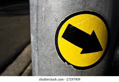 yellow circle sticker with black arrow