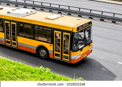 Yellow City Bus Moves along the Highway. View from above