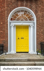 Yellow classic door in Dublin, example of georgian typical architecture of Dublin, Ireland