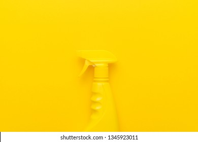 yellow cleaning spray on the yellow background with copy space