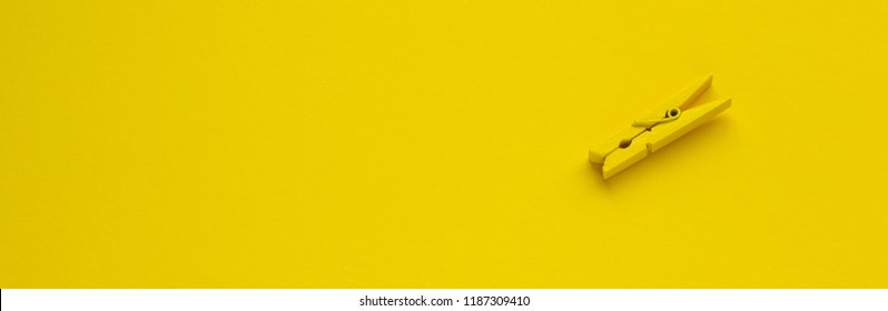 Yellow clothespin on the background, space for text