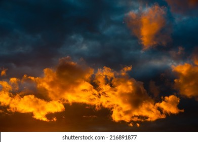 Yellow clouds in the dark sky (beautiful sunset)
