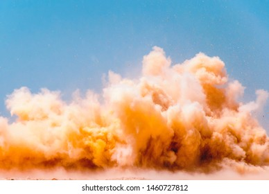Yellow clouds of the rock during detonator blast on the construction site