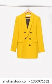 Yellow coat isolate on hanging