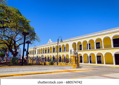 Yellow colonial building in street on the main plaza in Campeche, Mexico