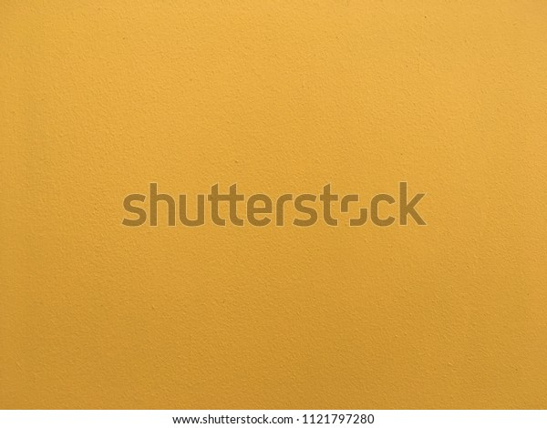 Yellow color concrete wall background for texture abstract