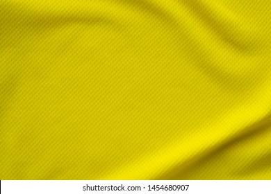Yellow color sports clothing fabric jersey football shirt texture top view close up