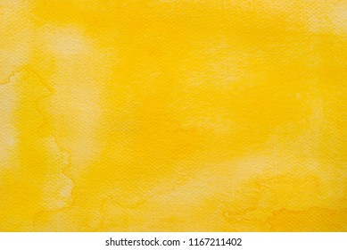 yellow color watercolor on paper painted background texture