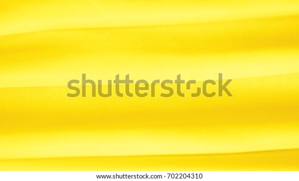 yellow colored silk texture luxurious satin for abstract background,design and wallpaper,soft and blur style,smooth.