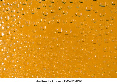 Yellow coloured  water droplet background