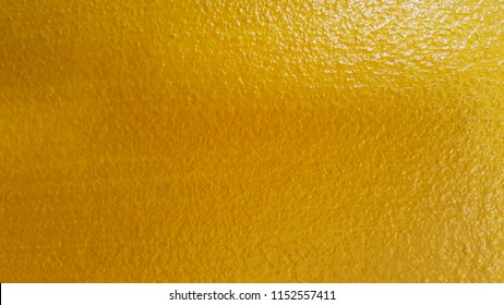 yellow concrete on the wall , texture background