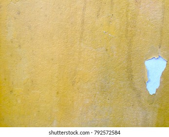 Yellow concrete paint wall texture for background abstract